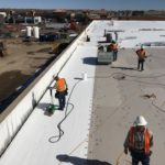 Commercial roofing company working on commercial roof