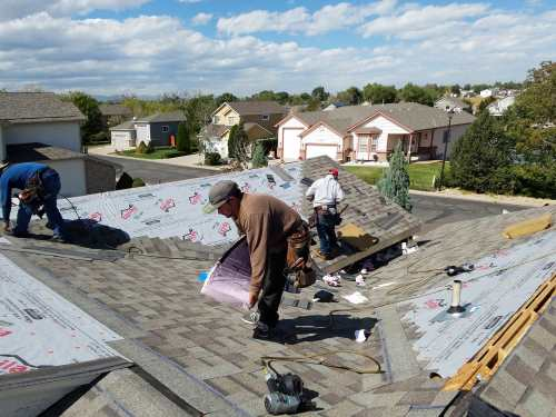 Workers on a Denver residential roof replacement