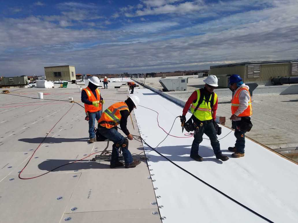 workers on commercial roofing in denver colorado