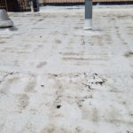 commercial roofing company picture of white cracked roof for roof repair
