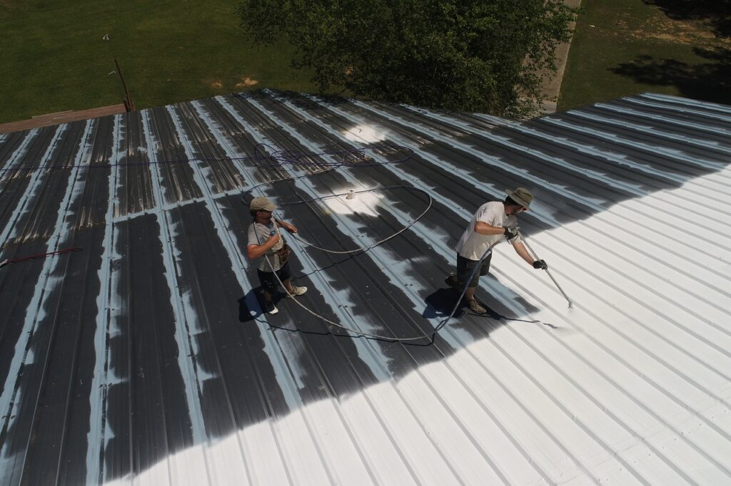 workers coating roof